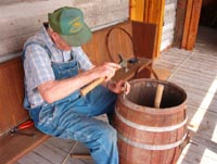 Volunteer, Bert Montgomery repairing an old barrel